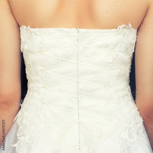 Canvas Print brides back in wedding white dress with lace