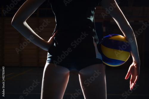 Fototapeta Žena volejbalový hráč s míčem