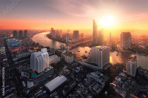 Canvas Print Bangkok city sunlight warm orange,sunrise in morning rooftop view, chao phraya r