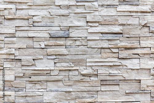 Exterior rock brick wall, background wall pattern.