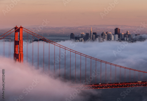 Golden gate bridge and city skyline in the fog, San Francisco, California, USA #83524810