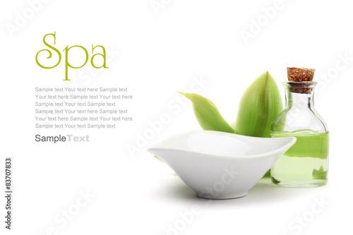 Spa concept. Green orchid, white vessel and spa oil.