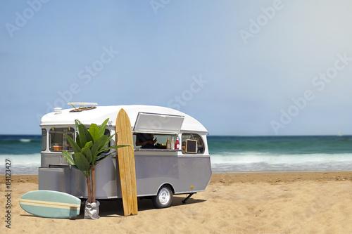 Slika na platnu Food truck caravan on the beach