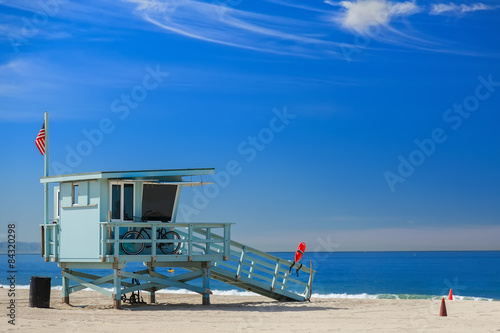 Canvas Print Lifeguard station with american flag on Hermosa beach