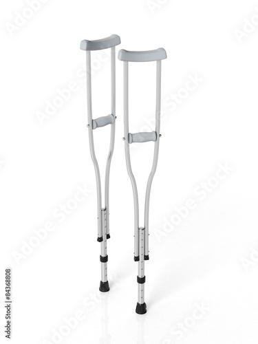 Valokuvatapetti Metallic crutches isolated on white background