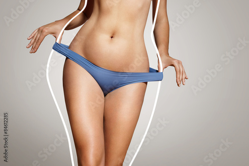 Slika na platnu loose weight concept, woman with a body lines before loose weigh