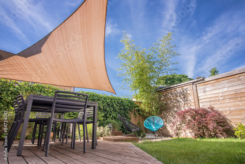 Modern house terrace in summer with table and shade sail Fototapeta