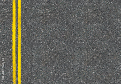 Photo Asphalt road top view with two yellow lines
