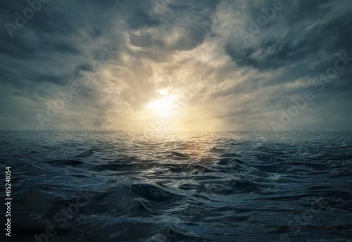 Sunset on stormy sea