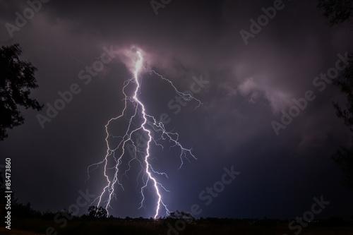 Lightning bolt in thunderstorm #85473860