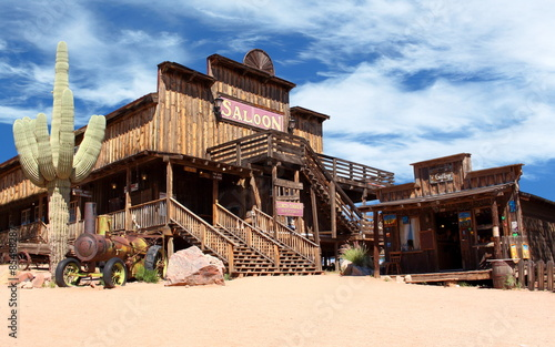 Fotografia, Obraz Old Wild West desert cowboy town with cactus and saloon