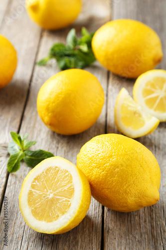 Lemons on grey wooden background