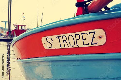 Fotografie, Obraz St. Tropez written in a boat, with a retro effect