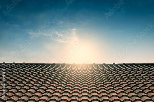 Carta da parati red tile roof blue sky,vintage filter