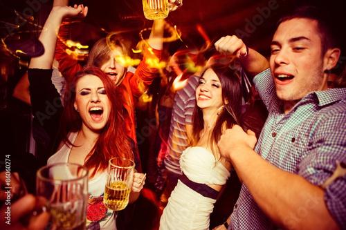 People in night club. Dancing, drinking and having fun
