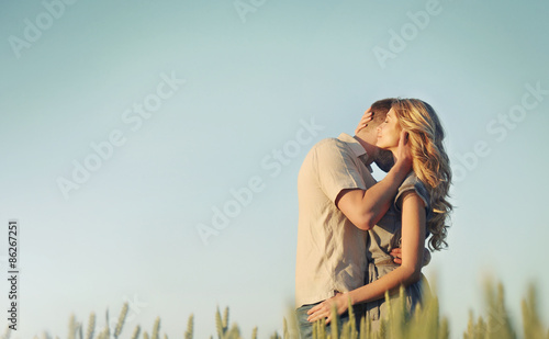 stunning sensual young couple in love embracing at the sunset in