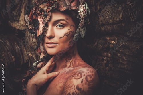 Fototapeta Nymph woman in a magical forest