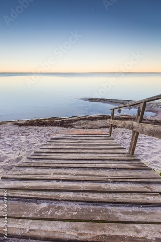 Landscape with wooden stairs leading to the sea