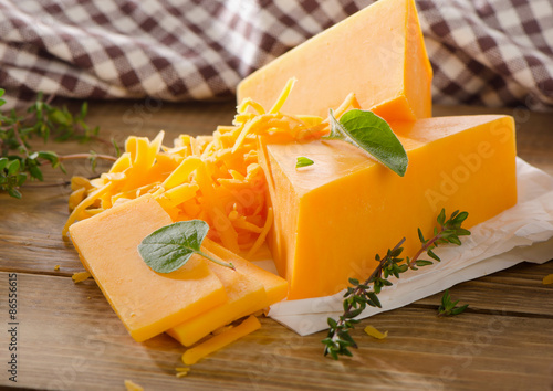 Cheese on  a rustic wooden background.