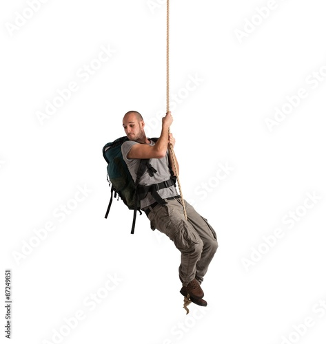 Explorer hanging from a rope Fototapeta
