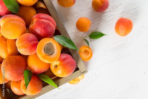 Fototapeta Fresh apricots on wooden table, close-up.