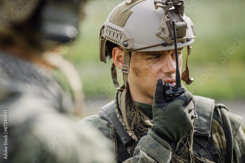 Foto officer holds a radio station, and give orders subdivision