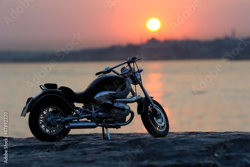 Canvas Print Motorcycle on the rocks in sunset and golden hours