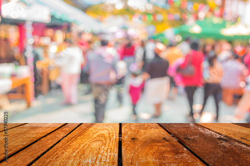 Fotografie, Tablou Blurred image of people walking at day market  in sunny day, blu