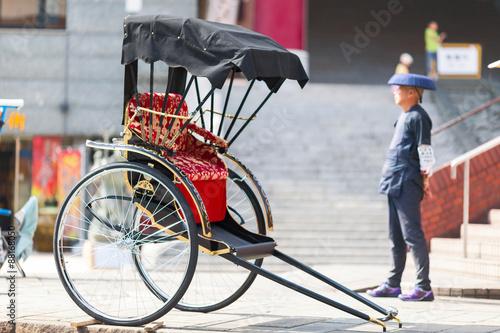 Fototapeta Japanese rickshaw man awaiting for the customers. Nagasaki