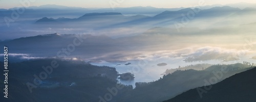 Adams Peak (Sri Pada) view at sunrise, mountains and the Maussakele Reservoir, Central Highlands, Sri Lanka #88352457