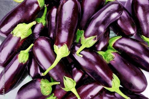 Heap of fresh eggplants close up