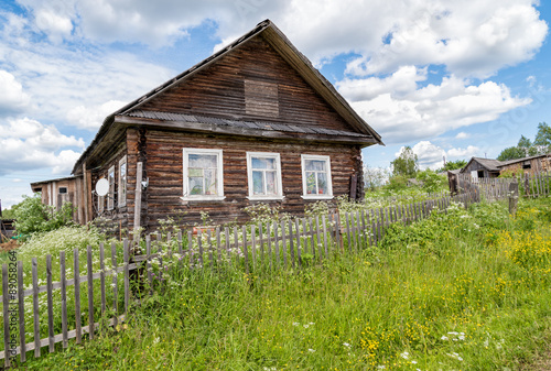 Old wooden house in Russian village #89058264