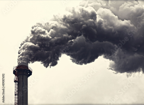 Leinwand Poster Dense smoke from a chimney