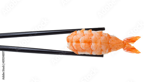 Shrimp sushi nigiri in chopsticks iolated on white background