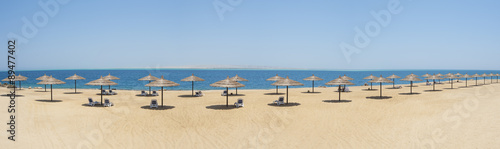 Tropical beach with parasols #89477402