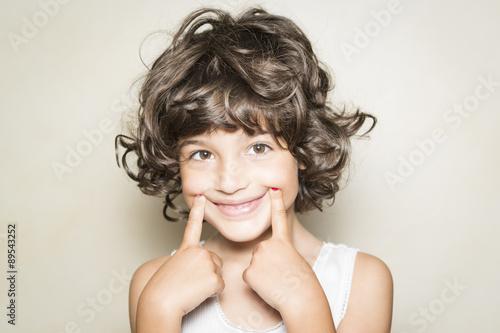 Fototapeta Niña mostrando sonrisa