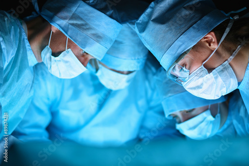 Fototapeta Young surgery team in the operating room