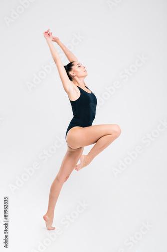 Obraz na plátně Žena v obleku gymnastka výstavním atletické dovednosti