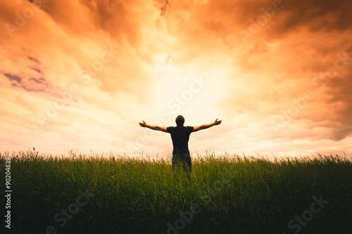 Obraz na plátně Silhouette of man and sunshine