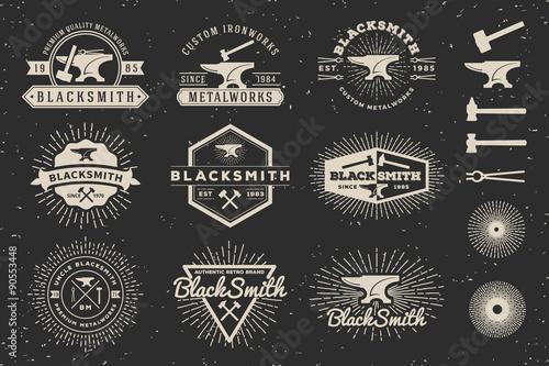 Obraz na płótnie Set of Modern Vintage Blacksmith and Metalworks insignia logotype Template Design with anvil, hammer, star burst