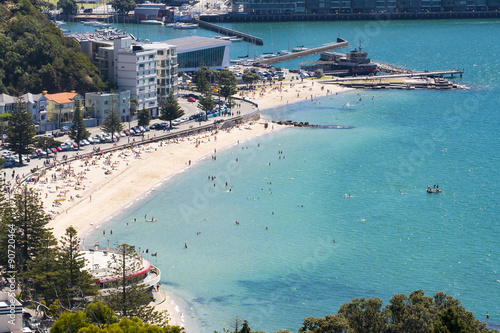 wellington's oriental Bay showing the beach in summer with people swimming and sunbathing