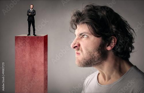 Slika na platnu Envious man looking at a manager