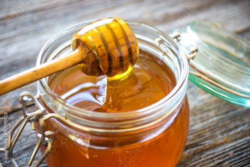 Canvas Print Honey drip in jar