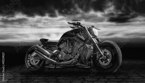 Canvas Print Composing with a motorcycle against dramatic sky in black and white