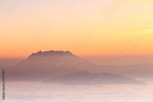 Mountain landscape with mist sunrise in Huai Nam Dang National P