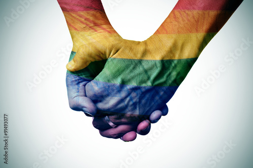 Canvas Print gay couple holding hands, patterned as the rainbow flag