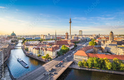 Photo Berlin skyline panorama with TV tower and Spree river at sunset, Germany