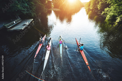 Team of rowing people