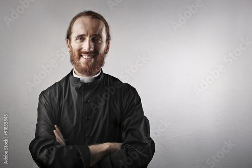 Obraz na płótnie Smiling priest