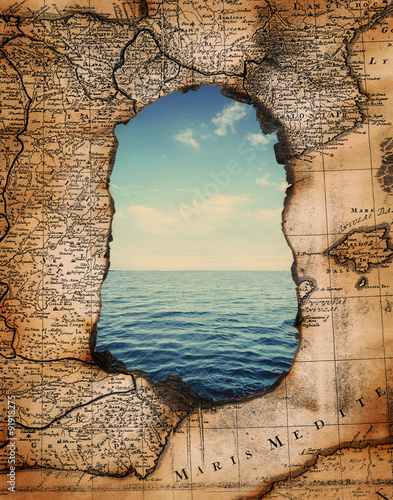 vintage burned-down map opens a view of the sea Fototapeta